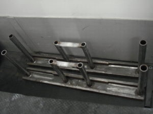 A picture of two homemade Farmer's Walk Handles that weigh about 100 pounds each.