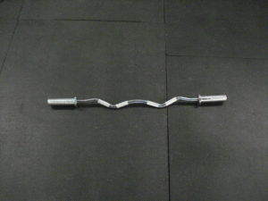 A picture of an E-Z Curl bar on a gym floor.