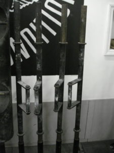 A picture of 4 Farmer's Walk Handles next to each other in a vertical bar holder.