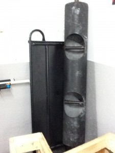 A picture of a strongman log leaning against the corner of a wall.
