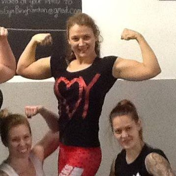 Picture Of Laura Monroe Aka The Chief Of Ironworks Gym Flexing Her Biceps