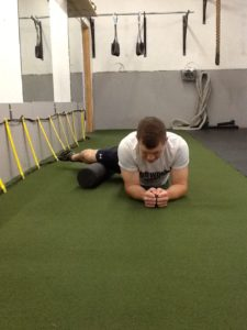 Dickie White rolling his right Adductor muscle with a Foam Roller.