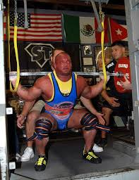 A picture of Eric Lilliebridge at the bottom of a squat in competition.