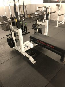 A competition bench with a Thompson Fat Pad.