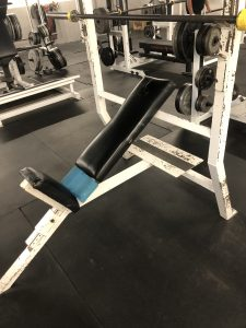 A barbell incline bench press
