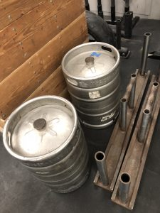 2 kegs and a pair of Farmer's Walk handles