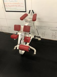 A plate loaded single leg hamstring curl machine