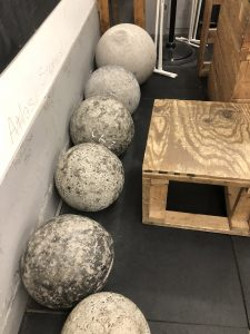 5 strongman Atlas stones of various weights and sizes